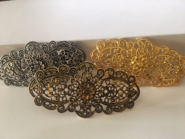 BROCHE METAL ORO